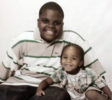 Michael Brown with his baby brother Andre at age 16.